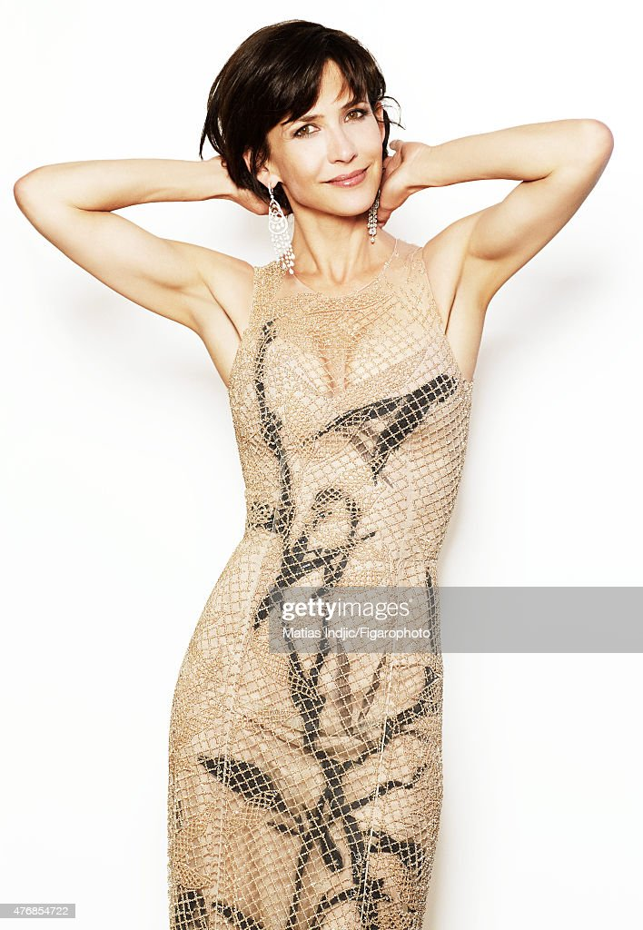 Actress <a gi-track='captionPersonalityLinkClicked' href=/galleries/search?phrase=Sophie+Marceau&family=editorial&specificpeople=220531 ng-click='$event.stopPropagation()'>Sophie Marceau</a> is photographed for Madame Figaro on May 24, 2015 at the Cannes Film Festival in Cannes, France. Dress (Giorgio Armani Privé), earrings and ring (Chopard). Make-up by LOréal Paris. PUBLISHED IMAGE.