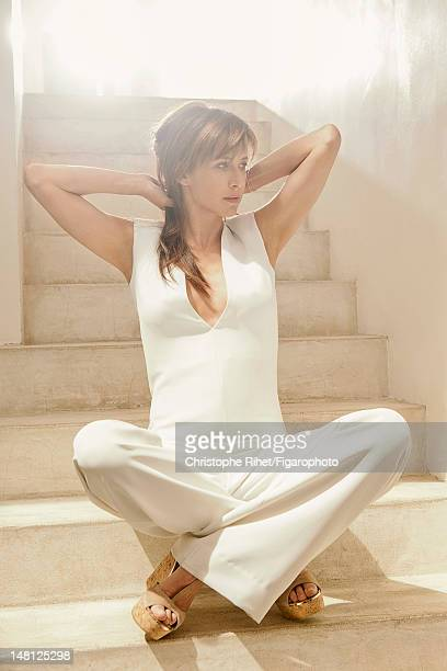 Actress Sophie Marceau poses for Madame Figaro on May 17 2012 in Paris France PUBLISHED IMAGE Figaro ID 104005006 Shirt and pants by Zapa jewelry by...