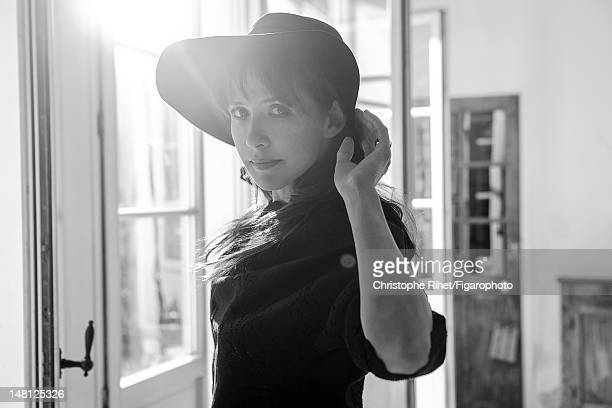 Actress Sophie Marceau poses for Madame Figaro on May 17 2012 in Paris France Figaro ID 104005011 Dress by Valentino hat by Maison Michel CREDIT MUST...