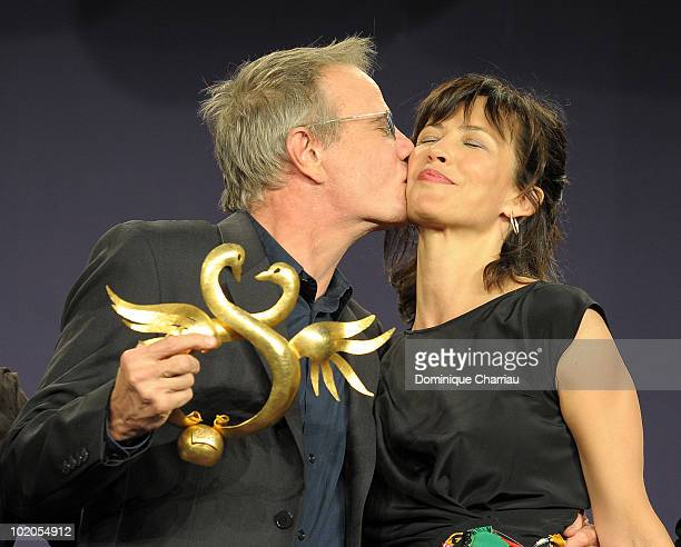 Actress Sophie Marceau presents the Award 'Coup de Coeur' to Actor Christopher Lambert on June 12 2010 in Cabourg France
