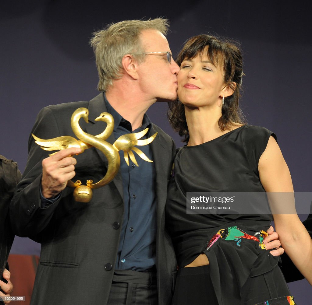 Actress <a gi-track='captionPersonalityLinkClicked' href=/galleries/search?phrase=Sophie+Marceau&family=editorial&specificpeople=220531 ng-click='$event.stopPropagation()'>Sophie Marceau</a> presents the Award 'Coup de Coeur' to Actor <a gi-track='captionPersonalityLinkClicked' href=/galleries/search?phrase=Christopher+Lambert&family=editorial&specificpeople=240500 ng-click='$event.stopPropagation()'>Christopher Lambert</a> on June 12, 2010 in Cabourg, France.