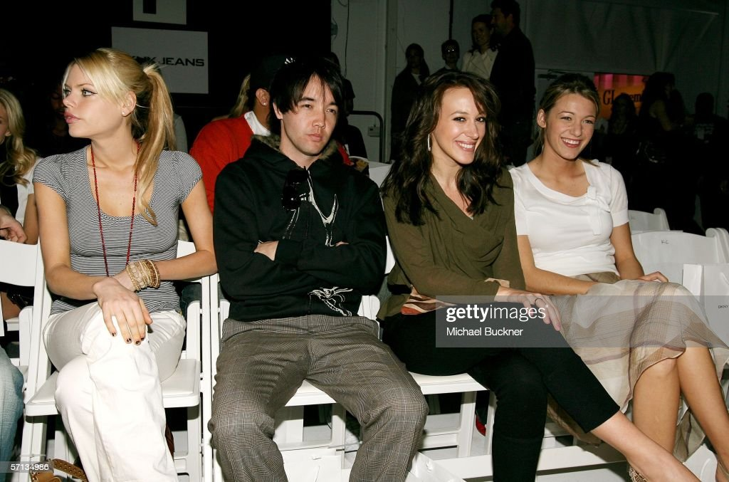 Actress Sophie Monk, singer Doug Robb of Hoobastank, actress Haylie Duff and guest in the front row at the Teen Vogue and DKNY JEANS Fall 2006 show during Mercedes-Benz Fashion Week at Smashbox Studios on March 19, 2006 in Culver City, California.