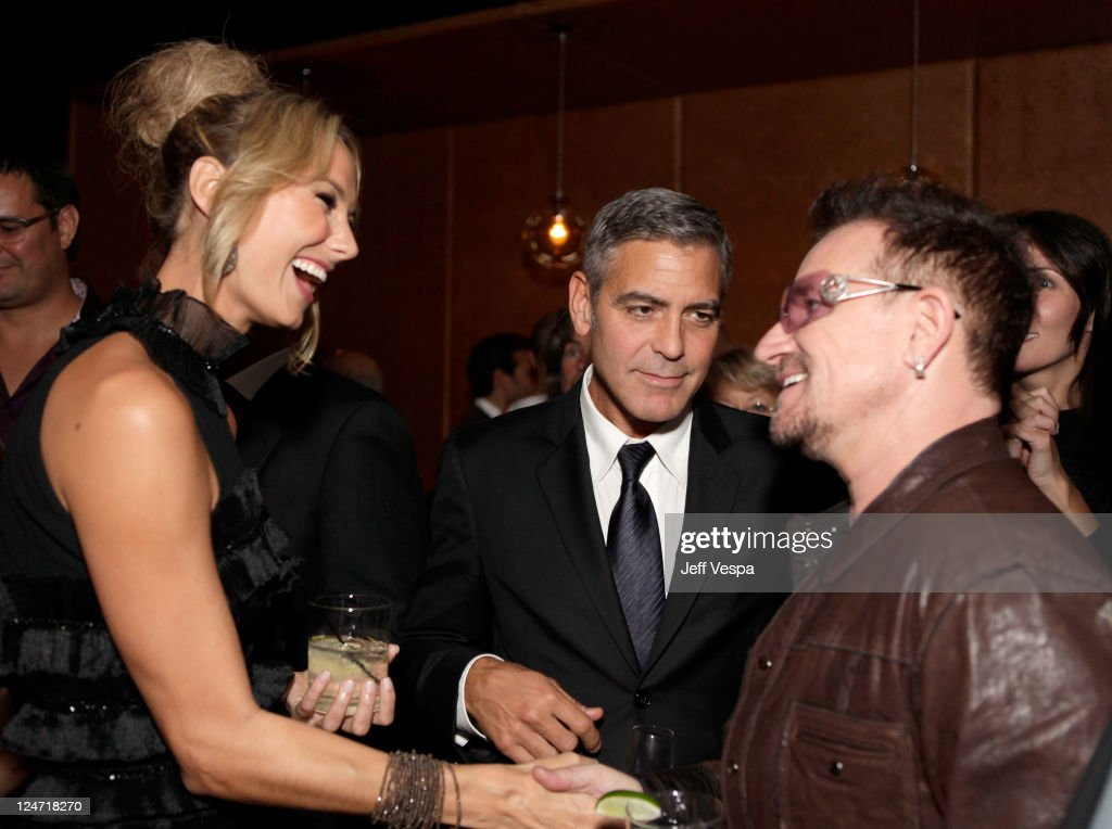 Actress Stacy Keibler, actor George Clooney and singer Bono of U2 attend the Fox Searchlight Pictures, Belvedere Vodka And Vanity Fair Celebration of 'Martha Marcy May Marlene' And 'The Descendants' at the 2011 Toronto International Film Festival at the Thompson Hotel on September 10, 2011 in Toronto, Canada.