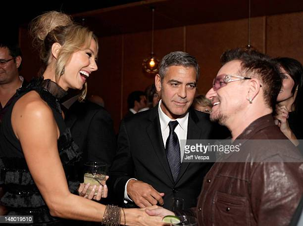 Actress Stacy Keibler actor George Clooney and singer Bono of U2 attend the Fox Searchlight Pictures Belvedere Vodka And Vanity Fair Celebration of...