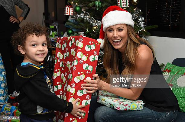 Actress Stacy Keibler and JAKKS Pacific toy company help donate hundreds of toys to Baby Buggy for families in need this holiday season on December...