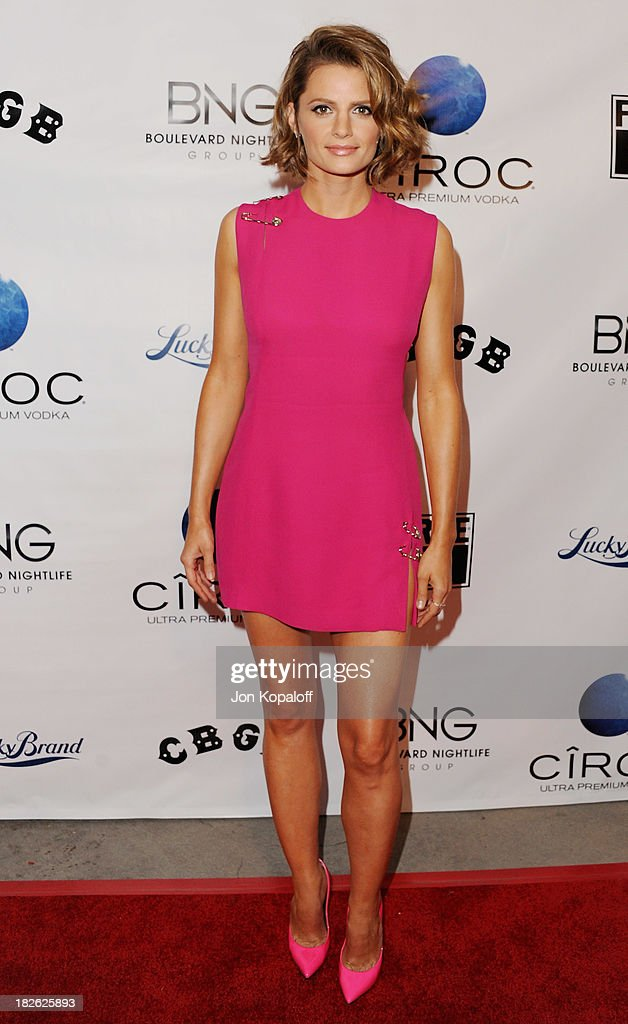 Actress <a gi-track='captionPersonalityLinkClicked' href=/galleries/search?phrase=Stana+Katic&family=editorial&specificpeople=2081035 ng-click='$event.stopPropagation()'>Stana Katic</a> arrives at the Los Angeles Premiere 'CBGB' at ArcLight Cinemas on October 1, 2013 in Hollywood, California.