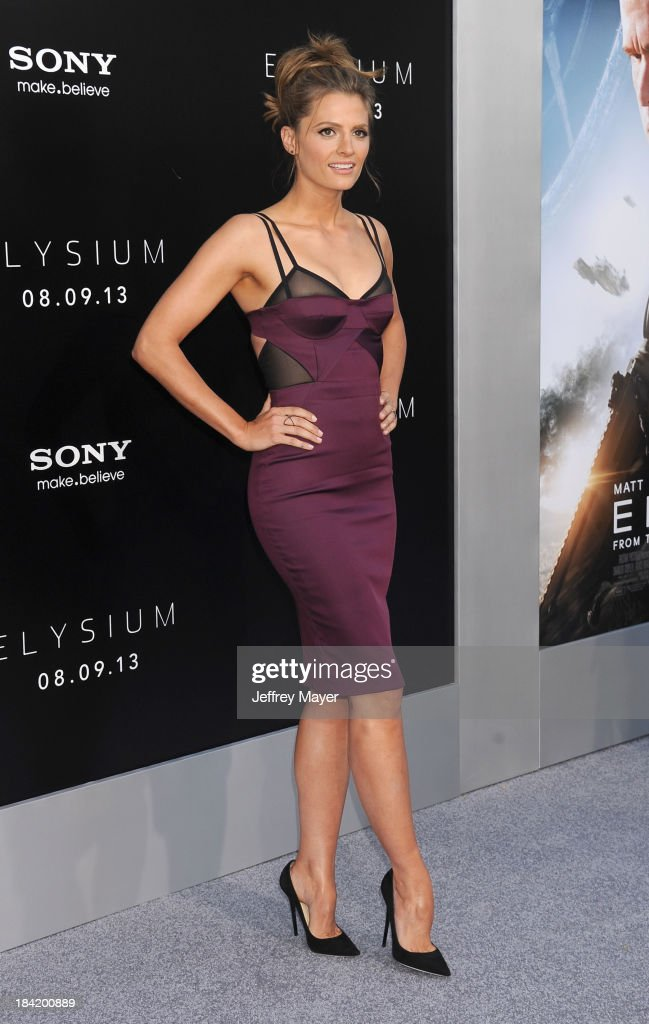 Actress Stana Katic arrives at the Los Angeles premiere of 'Elysium' at Regency Village Theatre on August 7, 2013 in Westwood, California.