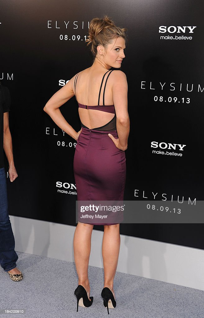 Actress <a gi-track='captionPersonalityLinkClicked' href=/galleries/search?phrase=Stana+Katic&family=editorial&specificpeople=2081035 ng-click='$event.stopPropagation()'>Stana Katic</a> arrives at the Los Angeles premiere of 'Elysium' at Regency Village Theatre on August 7, 2013 in Westwood, California.