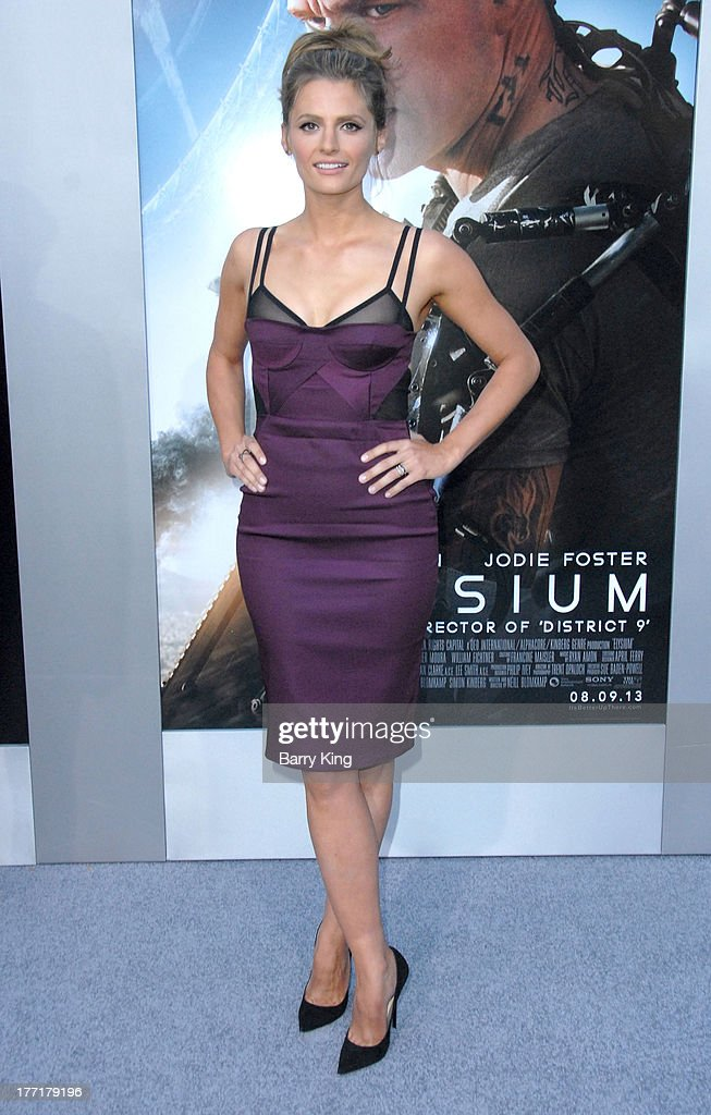 Actress Stana Katic arrives at the Los Angeles Premiere of 'Elysium' on August 7, 2013 at Regency Village Theatre in Westwood, California.