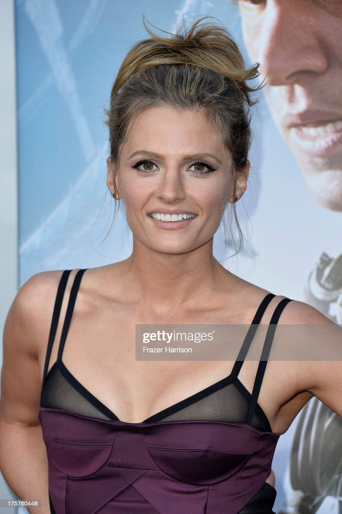 Actress Stana Katic arrives at the premiere of TriStar Pictures' 'Elysium' at Regency Village Theatre on August 7, 2013 in Westwood, California.