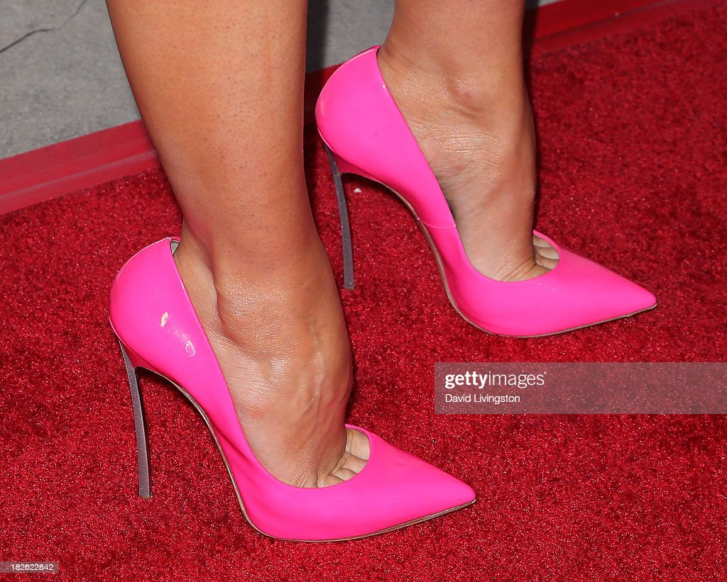 Actress Stana Katic (shoe detail) attends a screening of Xlrator Media's 'CBGB' at ArcLight Cinemas on October 1, 2013 in Hollywood, California.