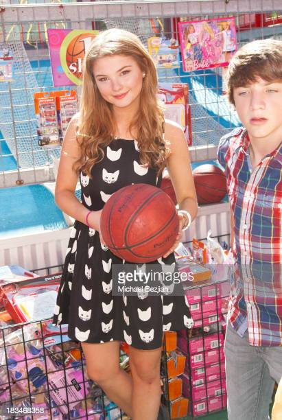 Actress Stefanie Scott volunteers at the 14th Annual 'Mattel Party On The Pier' Benefiting Mattel Children's Hospital UCLA at Santa Monica Pier on...