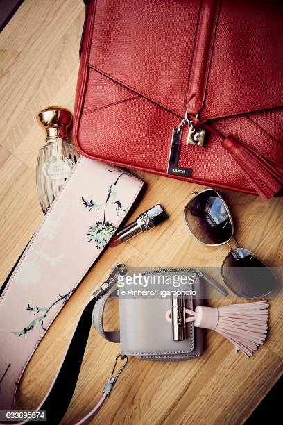 Actress Stefi Celma's style inspirations are photographed for Madame Figaro on September 20 2016 in Paris France Bag small bag lipstick sunglasses...