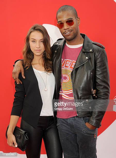 Actress Stella Maeve and recording artist Kid Cudi arrive at the Los Angeles premiere of 'Red 2' at Westwood Village on July 11 2013 in Los Angeles...