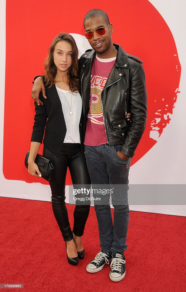 Actress Stella Maeve and recording artist Kid Cudi arrive at the Los Angeles premiere of 'Red 2' at Westwood Village on July 11, 2013 in Los Angeles, California.