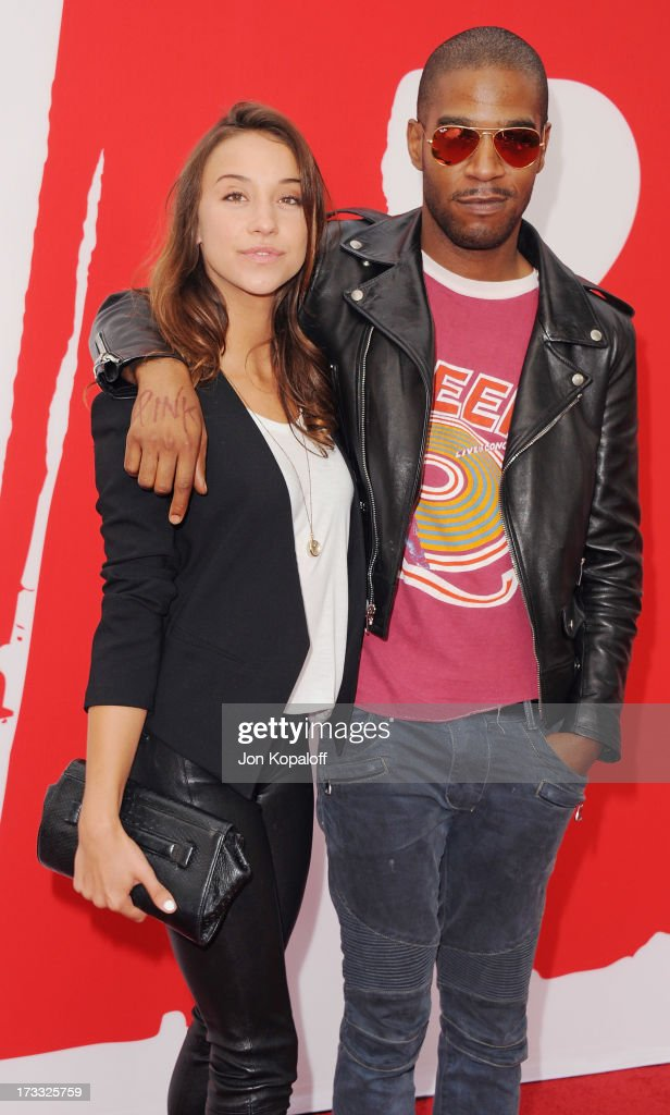 Actress Stella Maeve and singer Kid Cudi arrive at the Los Angeles Premiere 'Red 2' at Westwood Village on July 11, 2013 in Los Angeles, California.