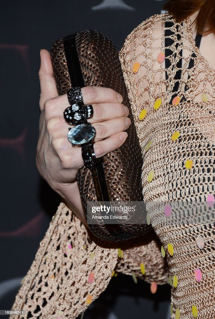 Actress Stephanie Erb (clutch and ring detail) arrives at the Los Angeles Premiere of 'The Devil's Dozen' at Mann's Chinese 6 Theatres on February 1, 2013 in Hollywood, California.
