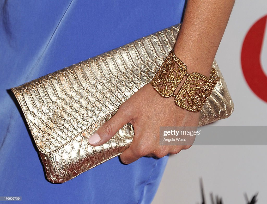 Actress Stephanie Leigh Schlund (purse detail) arrives at WWE and E! Entertainment's 'Superstars For Hope' at Beverly Hills Hotel on August 15, 2013 in Beverly Hills, California.