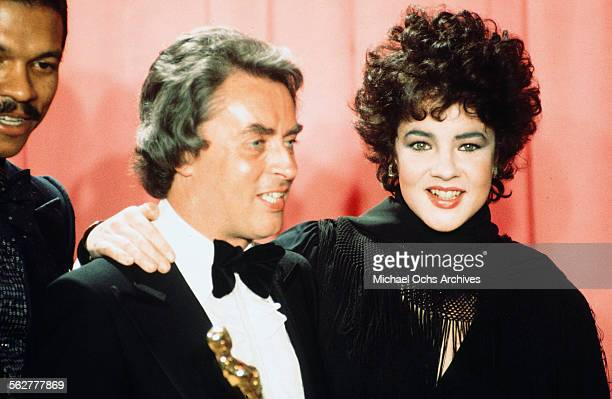 Actress Stockard Channing poses backstage with John Alcott winner of ' Best Cinematography during the 48th Academy Awards at Dorothy Chandler...