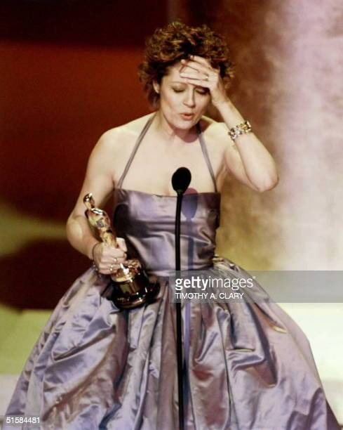Actress Susan Sarandon holds her head as she accepts her Oscar for Best Actress for her role in 'Dead Man Walking' at the 68th Academy Awards 25...