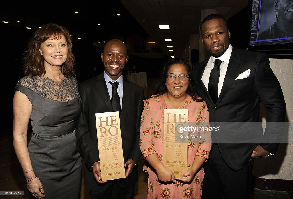Actress <a gi-track='captionPersonalityLinkClicked' href=/galleries/search?phrase=Susan+Sarandon&family=editorial&specificpeople=202474 ng-click='$event.stopPropagation()'>Susan Sarandon</a>, honoree Thulani Madondo of Kliptown Youth Program, honoree Pushpa Basnet of the Early Childhood Development Center, and rapper <a gi-track='captionPersonalityLinkClicked' href=/galleries/search?phrase=50+Cent+-+Rappare&family=editorial&specificpeople=215363 ng-click='$event.stopPropagation()'>50 Cent</a> (Curtis James Jackson III) attend the CNN Heroes: An All Star Tribute at The Shrine Auditorium on December 2, 2012 in Los Angeles, California. 23046_005_KM_0228.JPG