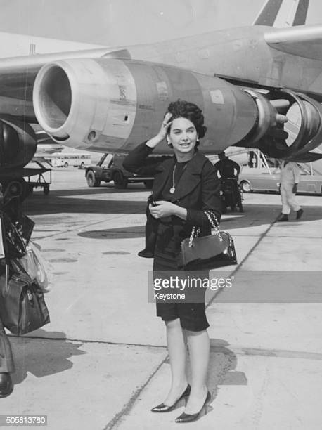 Actress Suzanne Pleshette standing next to an airplane as she arrives to star in the film 'Gli amanti devono imparare' Rome circa 1965