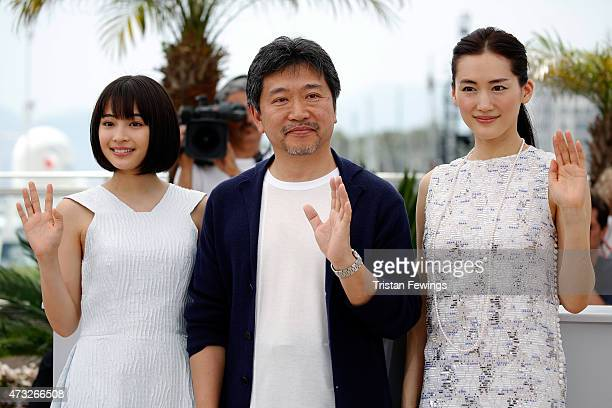 Actress Suzu Hirose director Hirokazu Koreeda and actress Haruka Ayase attend a photocall for 'Umimachi Diary' during the 68th annual Cannes Film...