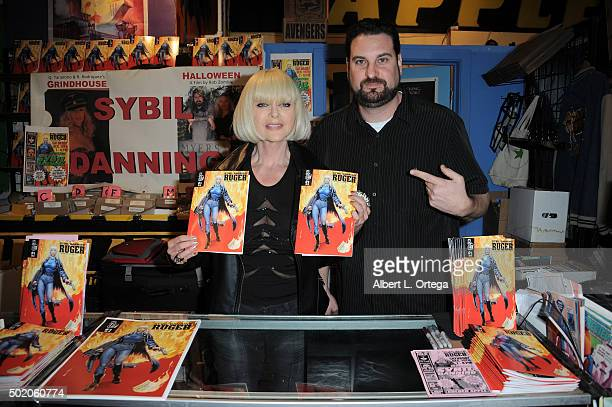 Actress Sybil Danning poses with her comic book 'Ruger' and propreiter Ryan Liebowitz At Golden Apple Comics held at Golden Apple Comics on December...