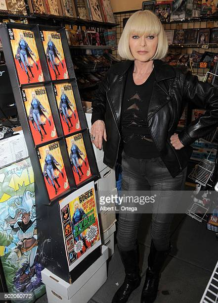 Actress Sybil Danning signs her comic book 'Ruger' At Golden Apple Comics held at Golden Apple Comics on December 19 2015 in Los Angeles California