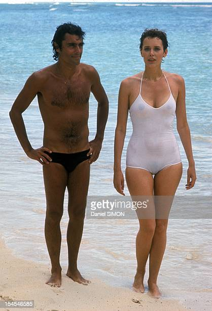 Actress Sylvia Kristel with her partner on set of movie 'Good Bye Emmmanuelle' directed by Francois Leterrier in April 1977 in Seychelles