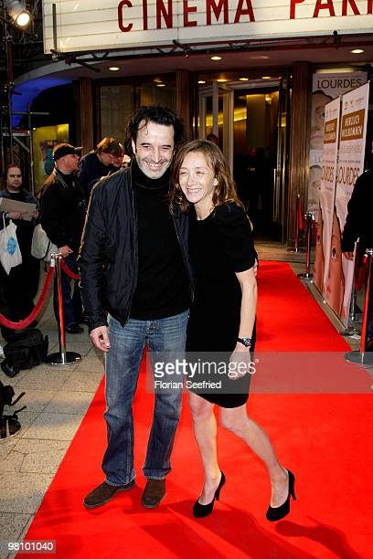 Actress Sylvie Testud and actor Bruno Todeschini attend the premiere of 'Lourdes' at cinema Paris on March 28 2010 in Berlin Germany