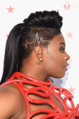 Actress Ta 'Rhonda Jones hair detail attends The American Heart Association's Go Red for Women Dress Collection 2016 at Skylight at Moynihan Station...