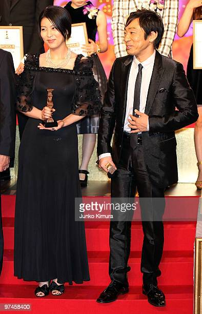 Actress Takako Matsu and actor Teruyuki Kagawa hold trophies during the 33rd Japan Academy Aawrds at Grand Prince Hotel New Takanawa on March 5 2010...