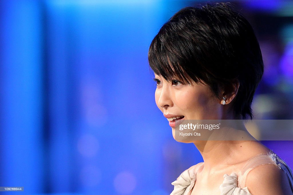 Actress Takako Matsu presents the award for Best Actor In A Leading Role on stage during the 34th Japan Academy Awards at Grand Prince Hotel New Takanawa on February 18, 2011 in Tokyo, Japan.