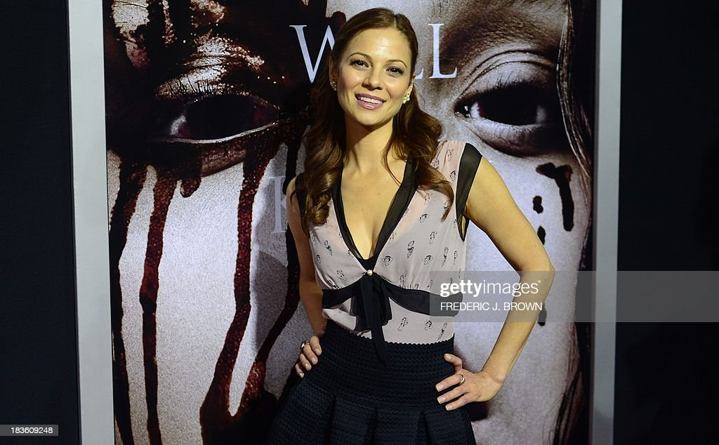 Actress Tamara Braun poses on arrival for the world premiere of the film 'Carrie' in Hollywood, California, on October 7, 2013. The remake of Stephen King's classic horror tale opens nationwide on October 18. AFP PHOTO/Frederic J. BROWN