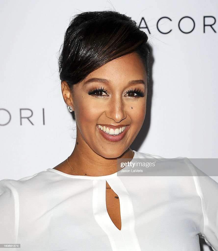 Actress <a gi-track='captionPersonalityLinkClicked' href=/galleries/search?phrase=Tamera+Mowry&family=editorial&specificpeople=798679 ng-click='$event.stopPropagation()'>Tamera Mowry</a> attends the Club Tacori 2013 event at Greystone Manor Supperclub on October 8, 2013 in West Hollywood, California.