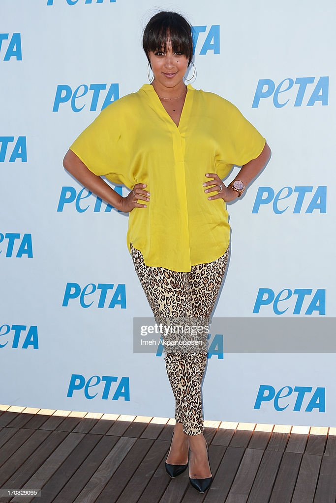 Actress <a gi-track='captionPersonalityLinkClicked' href=/galleries/search?phrase=Tamera+Mowry&family=editorial&specificpeople=798679 ng-click='$event.stopPropagation()'>Tamera Mowry</a>-Housley attends the unveiling of sister, Tia Mowry's sexy new PETA campaign at The Bob Barker Building on June 10, 2013 in Los Angeles, California.