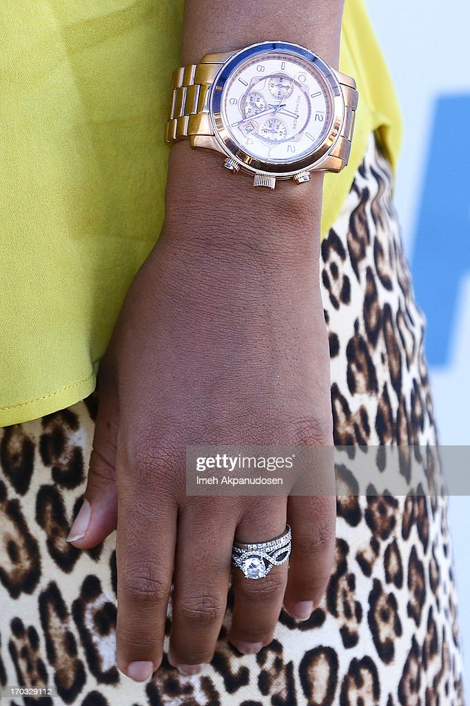 Actress <a gi-track='captionPersonalityLinkClicked' href=/galleries/search?phrase=Tamera+Mowry&family=editorial&specificpeople=798679 ng-click='$event.stopPropagation()'>Tamera Mowry</a>-Housley (watch and ring detail) attends the unveiling of sister, Tia Mowry's sexy new PETA campaign at The Bob Barker Building on June 10, 2013 in Los Angeles, California.