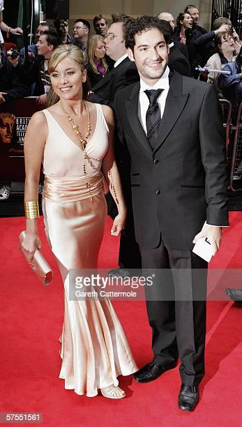 Actress Tamzin Outhwaite and fiance actor Tom Ellis arrive at the Pioneer British Academy Television Awards 2006 at the Grosvenor House Hotel on May...