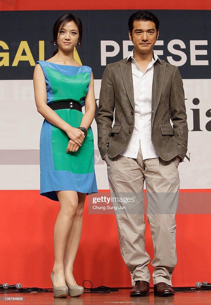 Actress Tang Wei and actor Takeshi Kanashiro attend at the Gala Presentation 'Wu Xia press conference at Shinsegae Centum city during the 16th Busan...