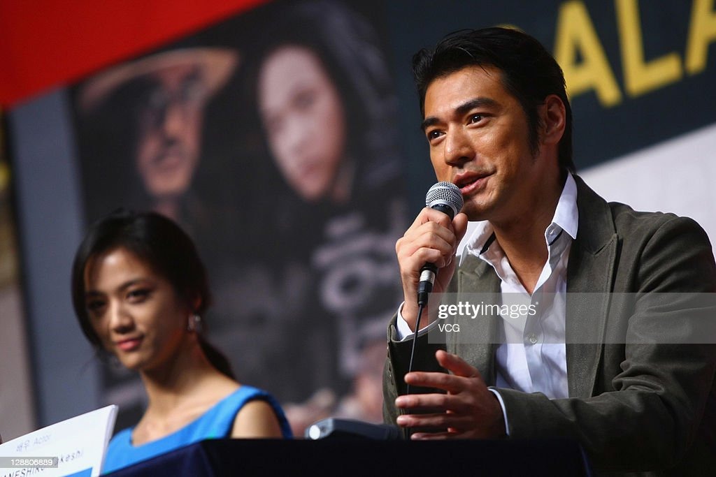 Actress Tang Wei and actor Takeshi Kanashiro attend the Gala Presentation 'Wu Xia' press conference at Shinsegae Centum city during the 16th Busan International Film Festival (BIFF) on October 9, 2011 in Busan, South Korea.