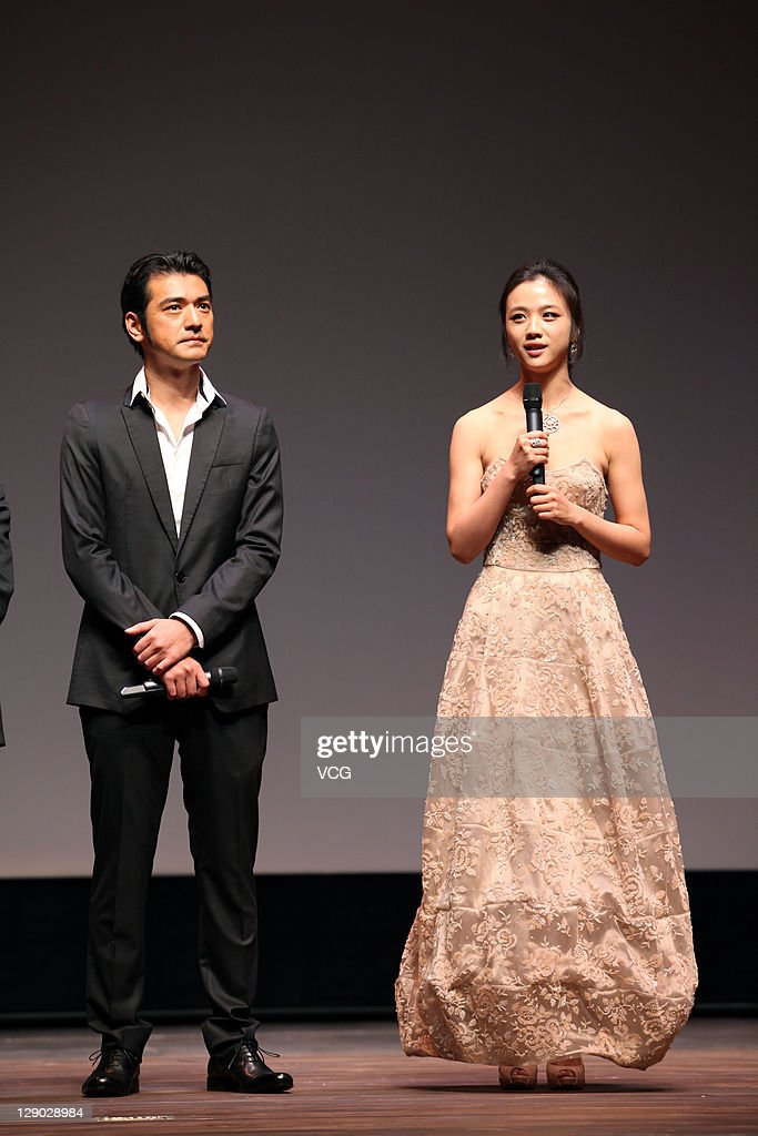 Actress <a gi-track='captionPersonalityLinkClicked' href=/galleries/search?phrase=Tang+Wei&family=editorial&specificpeople=4329520 ng-click='$event.stopPropagation()'>Tang Wei</a> and actor Takeshi Kanashiro attend 'Wu Xia' premiere at Haneulyeon Theatre during the 16th Busan International Film Festival (BIFF) on October 9, 2011 in Busan, South Korea.