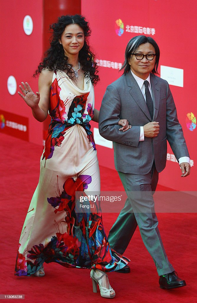 Actress Tang Wei and director Peter Chan arrive at the red carpet of the first Beijing International Film Festival at China's National Grand Theater...