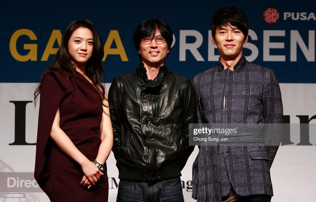 Actress Tang Wei director Kim TaeYong and actor Hyun Bin attend a photo call during their Gala Presentation of 'Late Autumn' of the 15th Pusan...