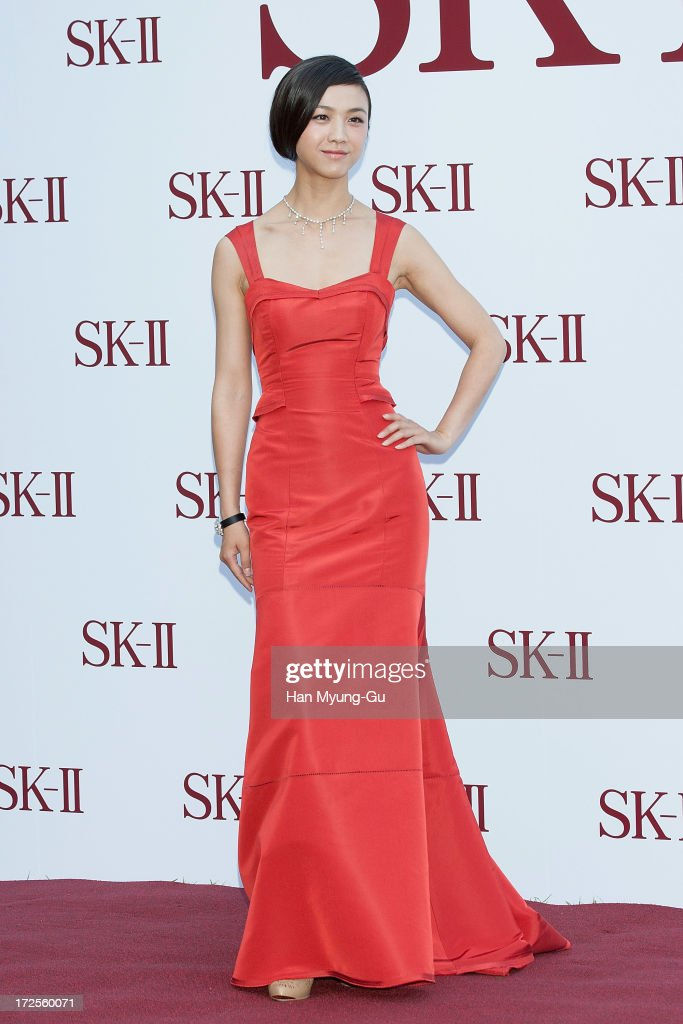Actress <a gi-track='captionPersonalityLinkClicked' href=/galleries/search?phrase=Tang+Wei&family=editorial&specificpeople=4329520 ng-click='$event.stopPropagation()'>Tang Wei</a> from China poses for the photogrpahs during the SK-II Honoring The Spirit Of Discovery event at the Raum on July 3, 2013 in Seoul, South Korea.
