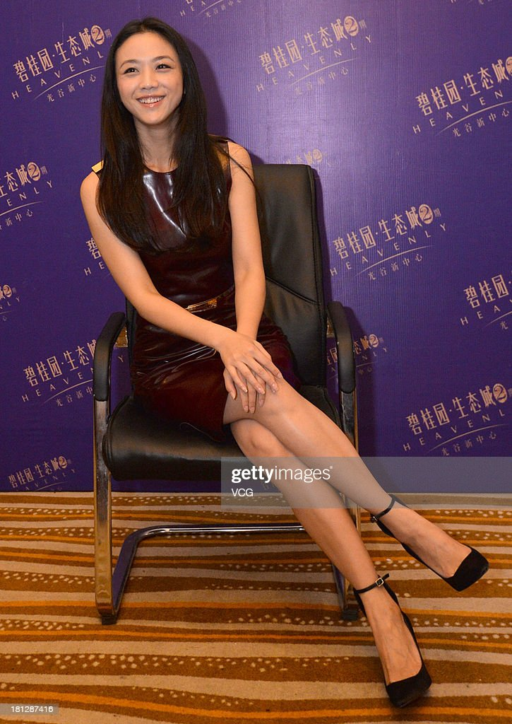 Actress <a gi-track='captionPersonalityLinkClicked' href=/galleries/search?phrase=Tang+Wei&family=editorial&specificpeople=4329520 ng-click='$event.stopPropagation()'>Tang Wei</a> meets fans at Country Garden Eco-City on September 20, 2013 in Wuhan, China.