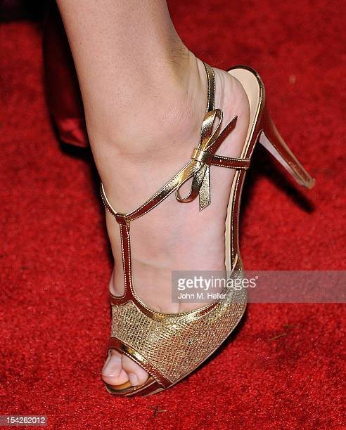 Actress Tanna Frederick wears Kate Spade Gold Jeweled open toe high heel shoes at the Project Save Our Surf Eco Chic Fashion Show at the Edgemar...