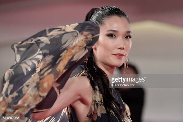 Actress Tao Okamoto attends the premiere of the movie 'Zhuibu' presented out of competition at the 74th Venice Film Festival on September 8 2017 at...