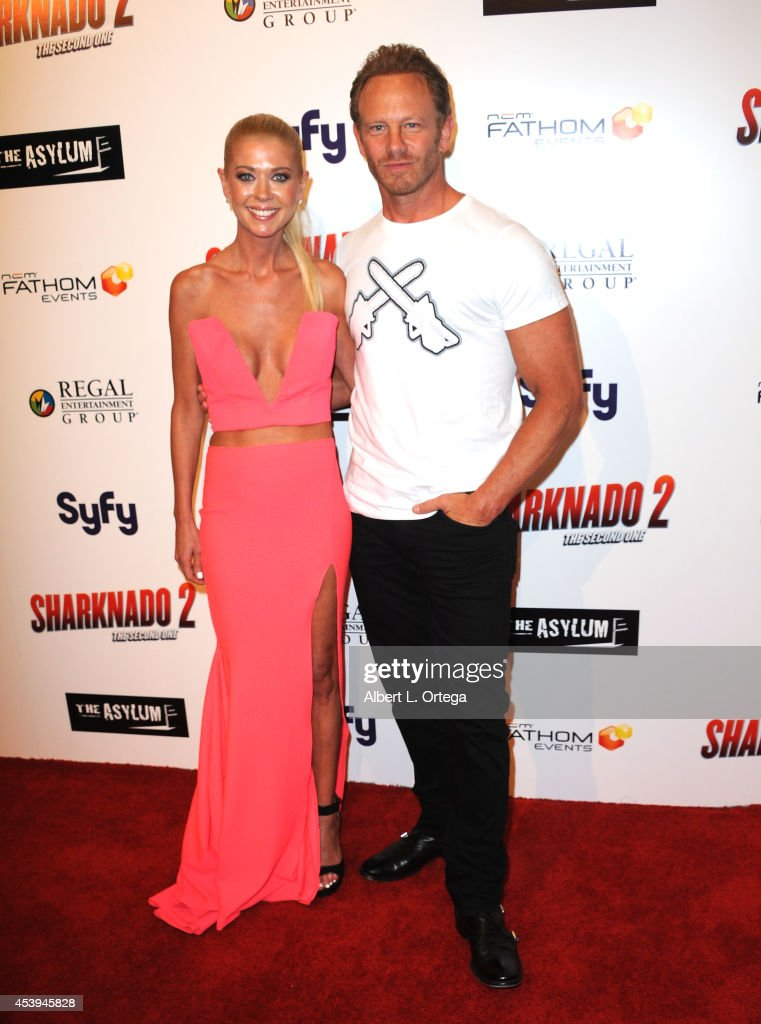 Actress Tara Reid and actor Ian Ziering arrive for the Premiere Of The Asylum Fathom Events' 'Sharknado 2 The Second One' held at Regal Cinemas LA...