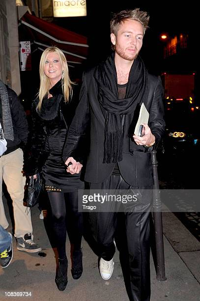 Actress Tara Reid and boyfriend Michael Lillelund leave the Valentino show as part of the Paris Haute Couture Fashion Week Spring/Summer 2011 at...